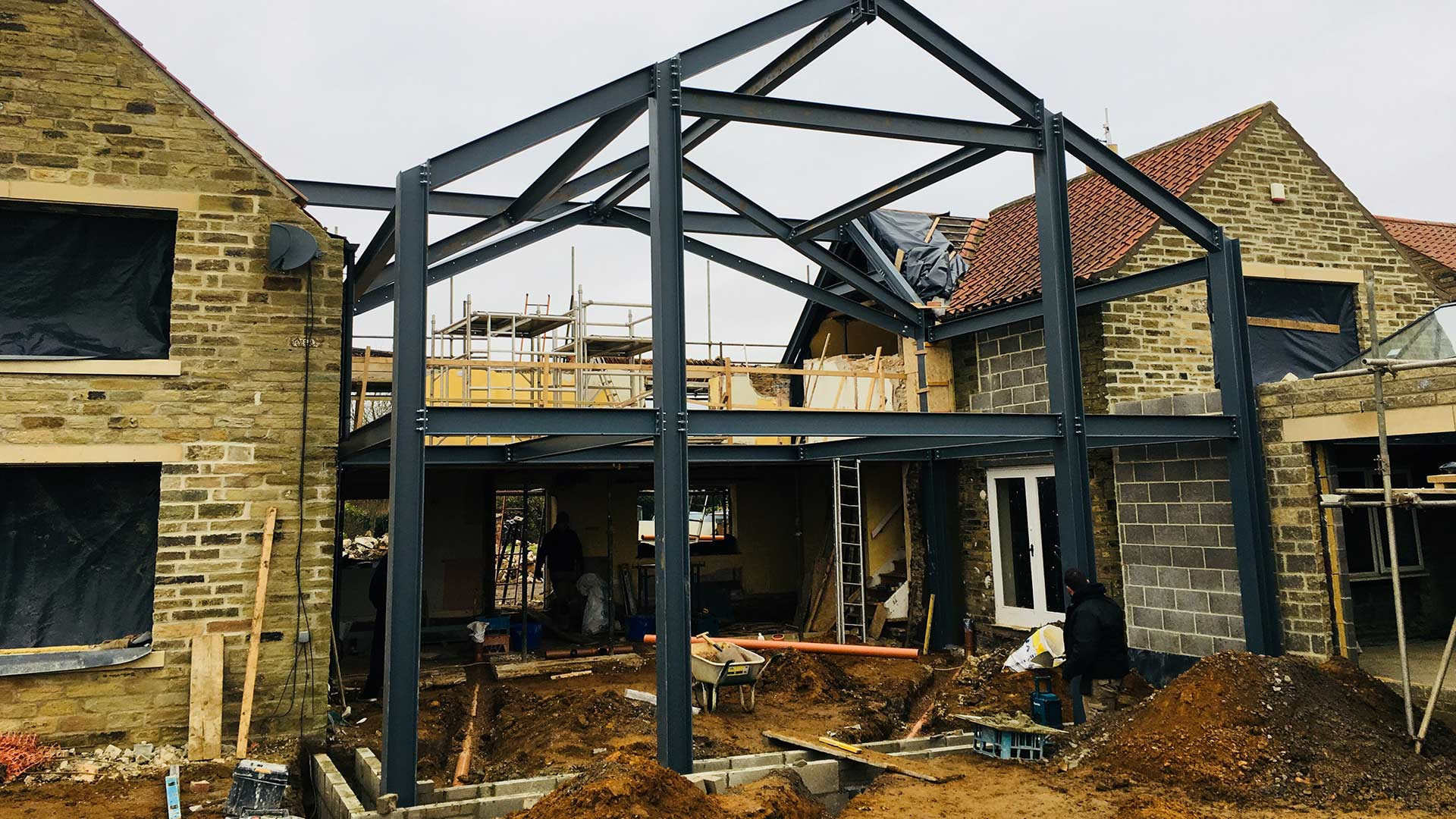 Photo of a steel frame structure attached to a house